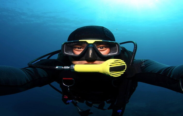 Angga dive instructor in Bali guides divers and snorkelers