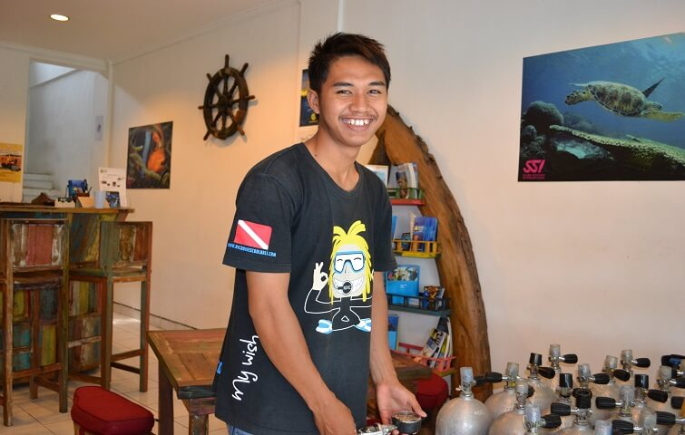 Hisyam, packing all the diving equipment at the dive center